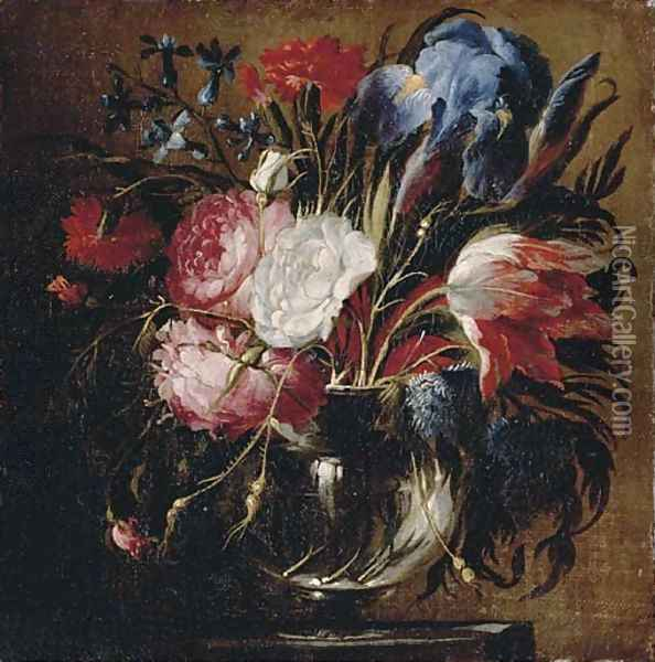 A tulip, carnations, roses, irises, bluebells and other flowers in a glass vase on a ledge Oil Painting - Juan De Arellano