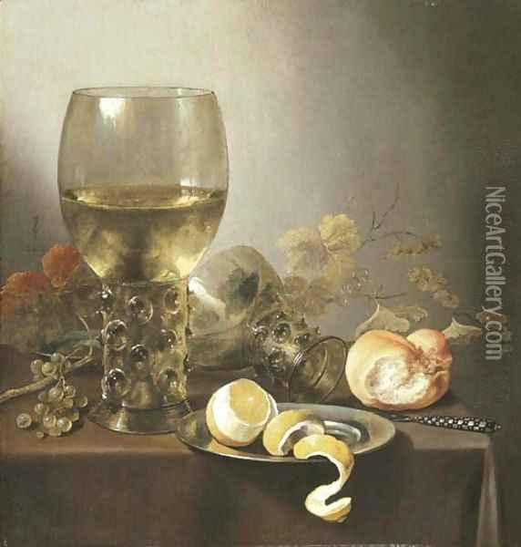 A giant roemer, an upturned roemer, grapes on the vine, a roll of bread, a knife and a partly-peeled lemon on a platter on a draped table Oil Painting - Pieter Claesz.
