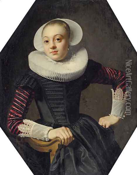 Portrait of a lady, seated three-quarter-length, in a black dress with red slashed sleeves, lace cuffs and a ruff Oil Painting - Thomas De Keyser