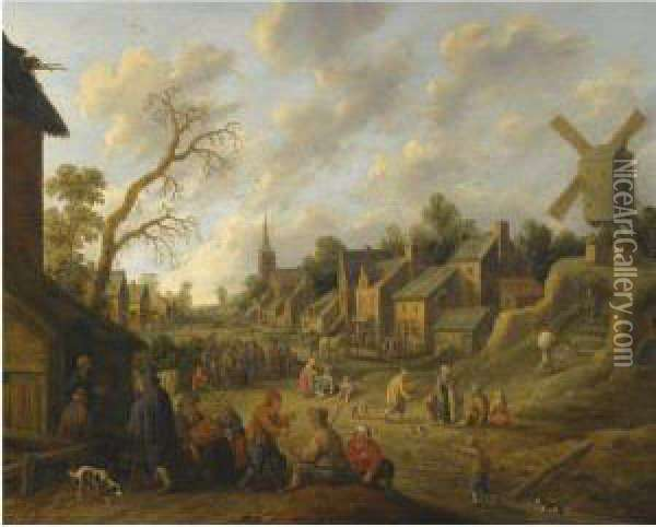 A Wide Street Through A Village Filled With Numerous Figures Andoverlooked By A Windmill Oil Painting - Joost Cornelisz. Droochsloot