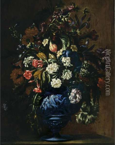 A Still Life With Roses,  Carnations, Poppy Anemones, Cornflowers, Irises, Lilies And Other  Flowers In A Blue Sculpted Stone Vase Oil Painting - Mario Nuzzi Mario Dei Fiori