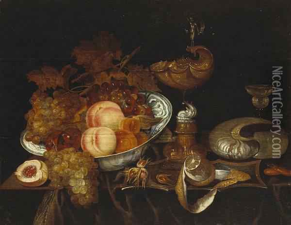 A Still Life Of Fruit In A Blue And Whitebowl, A Ewer, A Goblet, A Partially-peeled Lemon And A Nautilusshell, All Resting On A Partially Draped Table Oil Painting - Bartholomeus Assteyn