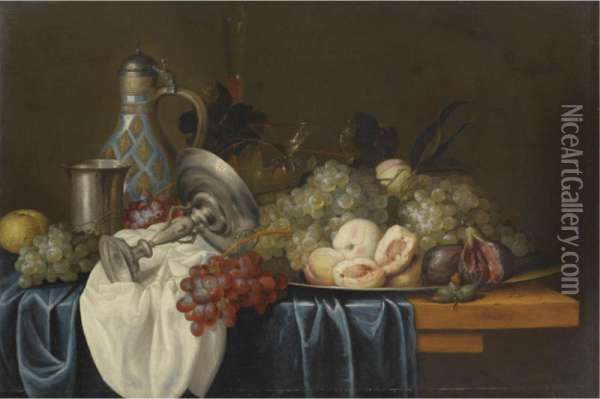 Still Life With Bunches Of Grapes, Peaches And Figs On A Pewter Dish, Together With A Silver Beaker And Tazza, A Wine Glass, A Flute And A Stoneware Jug, On A Table Draped With Blue And White Cloths Oil Painting - Alexander Coosemans